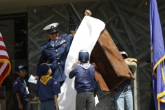 Cub Scouts assist in the unveiling of a steel I beam that was pulled from the World Trade center. The I beam was mounted to be on public display in front of the Rio Vista Fire department, for The 9-11 Memorial Dedication Ceremony at the Rio Vista Fire Department. Sunday. (Josh Redsun/Daily Republic photos)